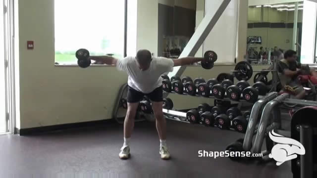 An image of a man performing the bent over dumbbell reverse fly exercise.