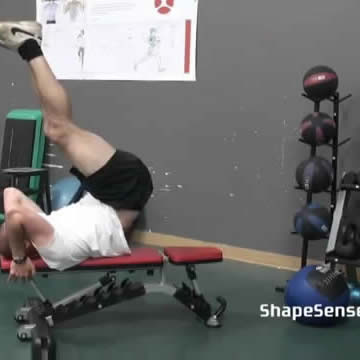 An image of a man performing the leg raise hip thrust exercise.