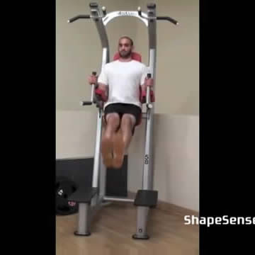 An image of a man performing the roman chair leg raise exercise.