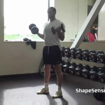 An image of a man performing the dumbbell curl exercise.