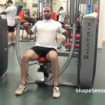 An image of a man performing the machine chest press exercise.