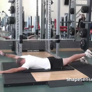 An image of a man performing the contralateral superman exercise.