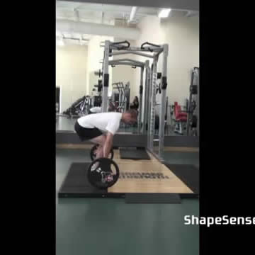 An image of a man performing the deadlift exercise.
