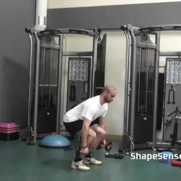 An image of a man performing the dumbbell jump squat exercise.