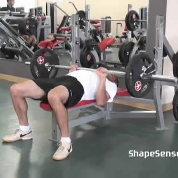An image of a man performing the close grip bench press exercise.