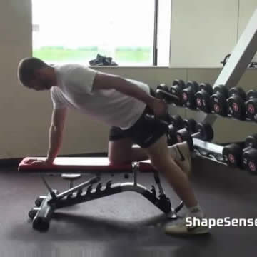 An image of a man performing the tricep kickback exercise.