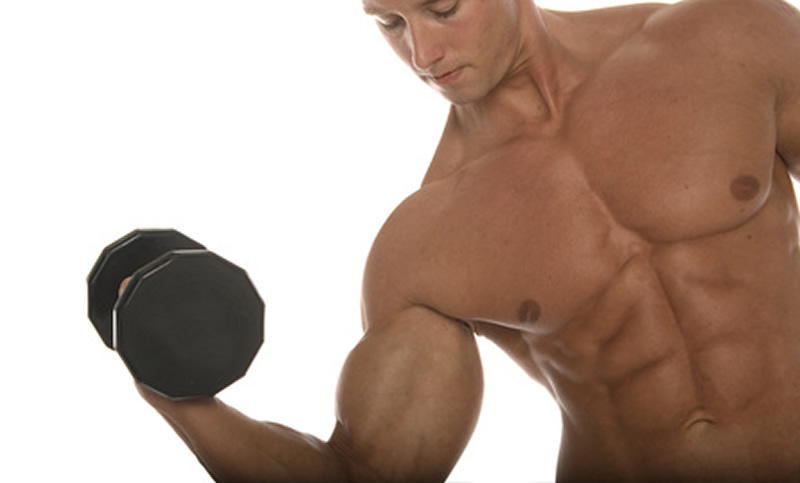 A fit man curling a dumbbell.
