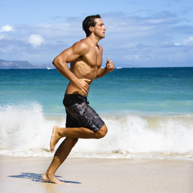A man running on the beach.