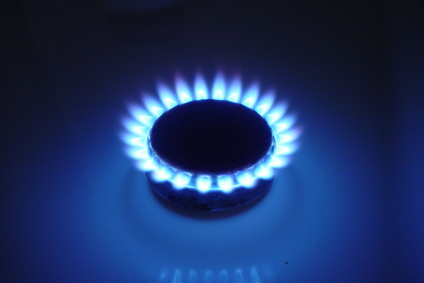 blue flames on an oven burner