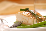 a thumbnail image of a cooked boneless, skinless chicken breast on a plate