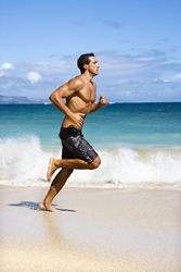 image of a man running on the beach