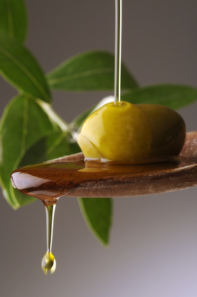olive oil dripping off a spoon