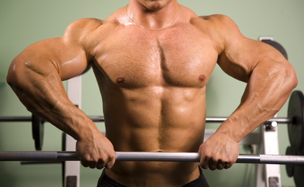 a muscular man performing a barbell upright row exercise