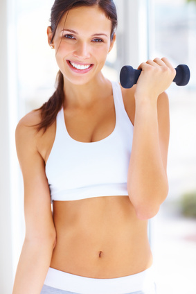 a woman exercising with a dumbell to get in shape