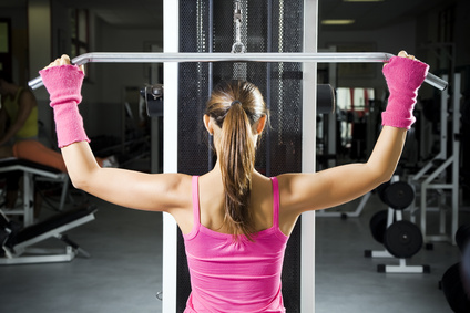 a woman performing lat pulldown exercises