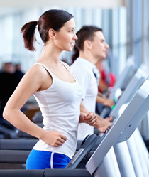 image of a woman walking on a treadmill